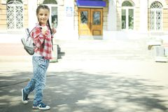 Schoolgirl with a schoolbag Royalty Free Stock Photography