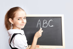 Schoolgirl about a schoolboard Royalty Free Stock Images