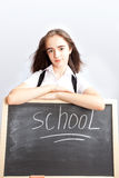 Schoolgirl about a schoolboard Stock Photos