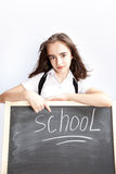 Schoolgirl about a schoolboard Royalty Free Stock Photography