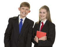 Schoolgirl And Schoolboy Holding Book Stock Photography
