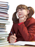 Schoolgirl, schoolwork and stack of books Royalty Free Stock Photography