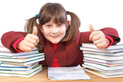 Schoolgirl, schoolwork and stack of books Royalty Free Stock Image