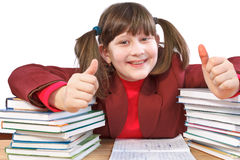 Schoolgirl, schoolwork and stack of books Royalty Free Stock Photo