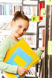 Schoolgirl searches books and holds exercise book Stock Images