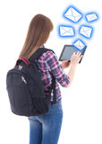 Schoolgirl sending messages with tablet computer isolated on whi Stock Image