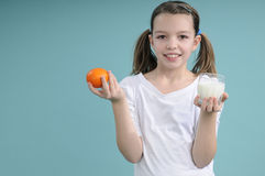 Free Schoolgirl Showing Fruits And Milk Stock Image - 18446391