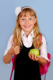 Schoolgirl showing good luck sign Royalty Free Stock Images