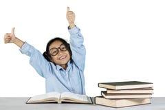 Schoolgirl showing ok gesture in studio Royalty Free Stock Photo