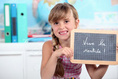 Schoolgirl showing a slate Royalty Free Stock Images