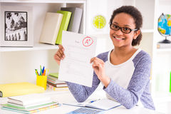 Schoolgirl showing test results Stock Photography