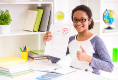 Schoolgirl showing test results Royalty Free Stock Photo