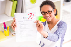 Schoolgirl showing test results Stock Images