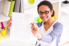 Schoolgirl showing test results Royalty Free Stock Image