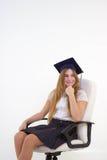Schoolgirl sit on chair Royalty Free Stock Photo