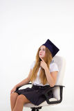 Schoolgirl sit on chair, thinking about future Royalty Free Stock Images