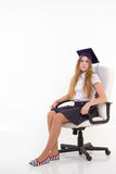 Schoolgirl sit on chair, thinking about future Stock Image