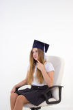 Schoolgirl sit on chair, thinking about future Royalty Free Stock Photography