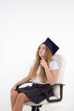Schoolgirl sit on chair, thinking about future Stock Images