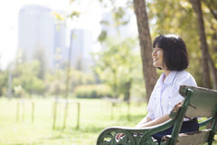Schoolgirl sitting on the bench. Royalty Free Stock Images