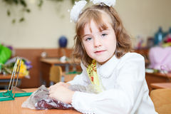 Schoolgirl sitting at the desk in school Stock Photos