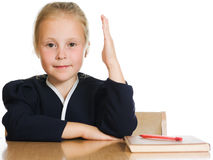 Schoolgirl is sitting at his desk Stock Photography