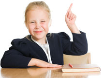 Schoolgirl is sitting at his desk Royalty Free Stock Image