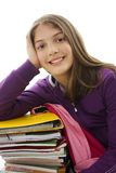 Schoolgirl sitting leans on school bag and books Royalty Free Stock Photography