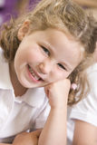 Schoolgirl sitting in primary class Royalty Free Stock Images