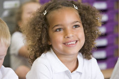 Schoolgirl sitting in primary class Stock Images