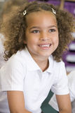 Schoolgirl sitting in primary class Royalty Free Stock Image