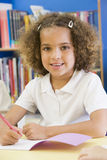 A schoolgirl sitting in a primary class Royalty Free Stock Photos