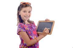 Schoolgirl with a slate Stock Images