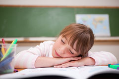 Schoolgirl sleeping on a desk Royalty Free Stock Photography