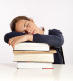 Schoolgirl sleeping on her books Stock Images