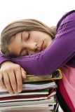 Schoolgirl sleeping on school bag and books Stock Photo