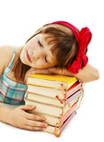 Schoolgirl sleeping on school book Royalty Free Stock Image