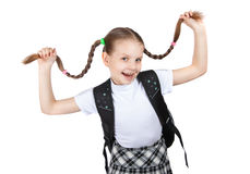 Schoolgirl smiling girl keeps herself pigtails Royalty Free Stock Photography