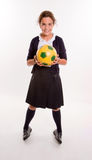 Schoolgirl and soccer Stock Image