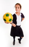 Schoolgirl with soccer ball Stock Images