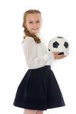 Schoolgirl with soccer ball Royalty Free Stock Photo