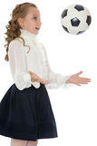 Schoolgirl with soccer ball Stock Image