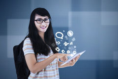 Schoolgirl with social media icon on tablet Royalty Free Stock Image