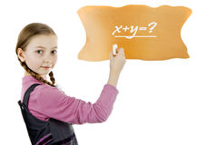 Schoolgirl solves the equation Royalty Free Stock Photo