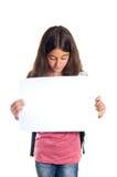 Schoolgirl som rymmer blankt papper Fotografering för Bildbyråer