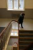 Schoolgirl in staircase. Schoolgirl walking down the staircase in an old school building Royalty Free Stock Images