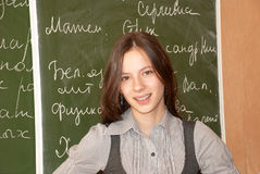 Schoolgirl standing at the blackboard Stock Photography
