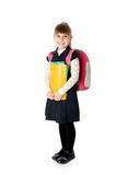 Schoolgirl is standing with folders in hands Stock Images