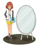 A schoolgirl standing beside the mirror Stock Photography