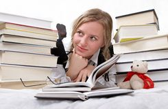 Schoolgirl or student reading books. Interesting books. She is happy on white Royalty Free Stock Photography
